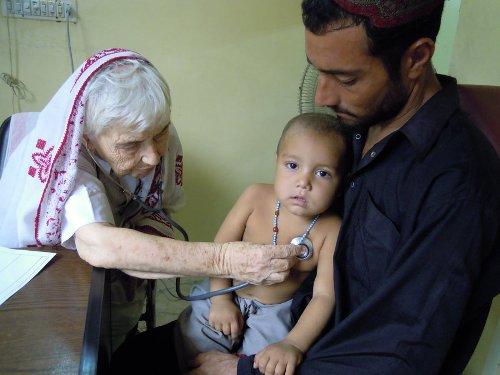 Dr Ruth Pfau examining a baby in Pakistan